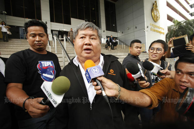 Premchai Karnasuta, president of Italian-Thai Development Plc, speaks briefly to reporters as he leaves the Criminal Court in Bangkok on Monday. (Photos by Pornprom Satrabhaya)