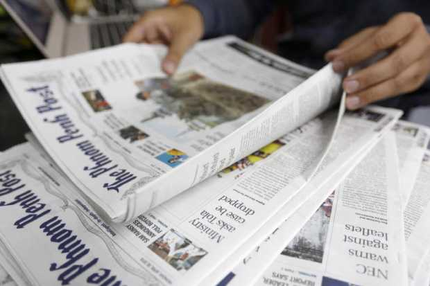 A person reads an issue of The Phnom Penh Post newspaper at an office in Phnom Penh, Cambodia on Monday. (EPA photo)