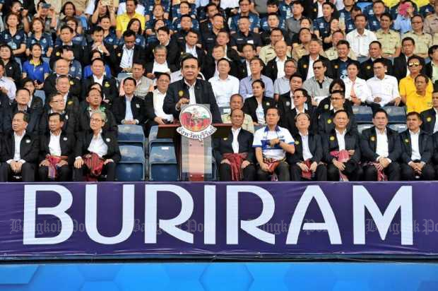 Prime Minister Gen Prayut addresses a crowd at Chang Arena, Muang, Buri Ram on Monday.