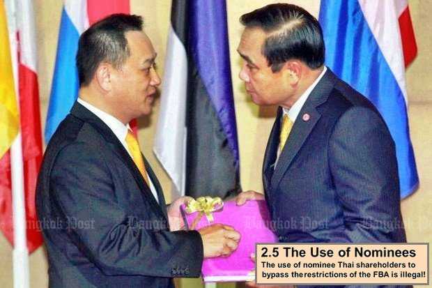 Stanley Kang, chairman of the Joint Foreign Chambers of Commerce in Thailand has a word with Prime Minister Prayut Chan-o-cha at a JFCCT dinner event which touched on the Foreign Business Act (FBA). (File photo by Somchai Poomlard)