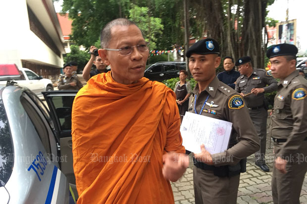 Phra Phrom Dilok, a member of the Sangha Supreme Council and abbot of Wat Sam Phraya, is arrested at his temple in Phra Nakhon district, Bangkok, about 6am on Thursday. (Photo by Wassayos Ngamkham)