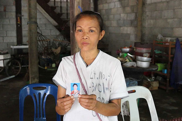 Jandee Boonbandong, the 45-year-old mother of Thanya Kongpeera, shows a photo of her daughter, who reportedly hanged herself at an emergency shelter in Malaysia after being rescued from the flesh trade. The mother suspects foul play, and insists her daughter would never have killed herself. (Photo by Chakkrapan Natanri)