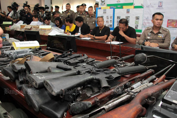 Police show the seized weapons and the five suspects at a press conference at the Crime Suppression Division in Bangkok on Friday. (Photo by Tawatchai Kemgumnerd)