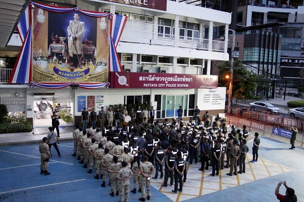 Teams of officers assemble at Pattaya City police station early on Wednesday  morning as an operation to