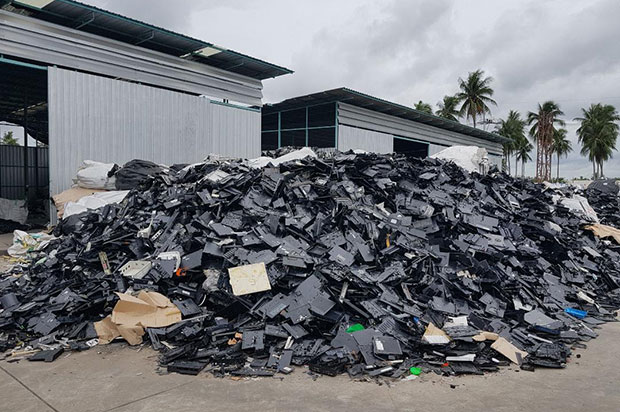 One of the piles of hazardous electronic waste in the compound of the D.K Plastic (Thailand) plastic recycling factory operated illegally by Chinese nationals in tambon Takhian Tia, Chon Buri. (Photo by Chaiyot Pupattanapong)
