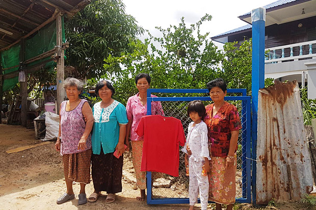 A red shirt is hung in front of a family's house to prevent what they call 'widow ghost' from visiting. Photo by Prasit Tangprasert