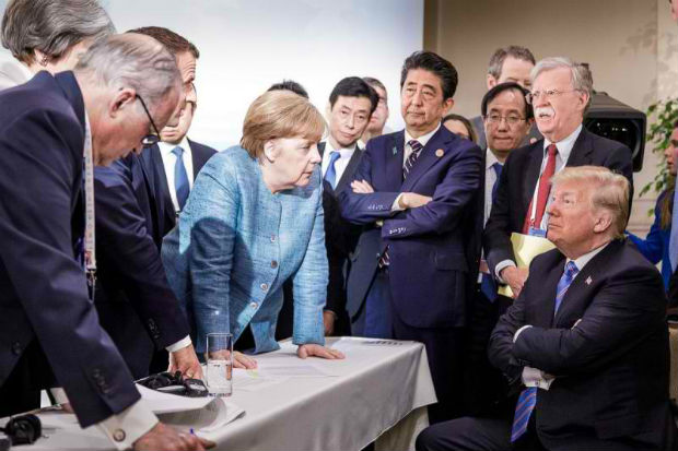 Photo released on Twitter by the German Government's spokesman Steffen Seibert on Saturday and taken by the German government's photographer Jesco Denzel shows US President Donald Trump (right) talking with German Chancellor Angela Merkel (centre) and surrounded by other G7 leaders during a meeting of the G7 Summit in La Malbaie, Quebec, Canada. (AFP photo)