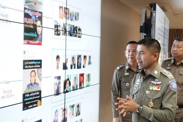 Deputy Tourist Police chief Surachate 'Big Joke' Hakparn shows media his briefing board to press charges against a London-based Facebook user for spreading 'fake news' on the satellite plans (top) and an 'altered photo' of Prime Minister Prayut Chan-o-cha. (Photo via Tourist Police)