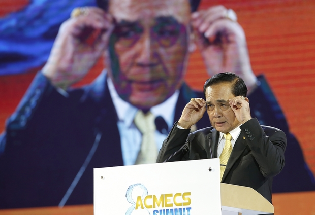 Prime Minister Prayut Chan-o-cha speaks to reporters following the Acmecs Strategy Summit in Bangkok on Saturday. (EPA-EFE Photo)