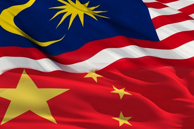 The flags of China and Malaysia. China's Communist Party mouthpiece has warned Dr Mahathir about backing off projects with Chinese investment. (Graphic supplied)