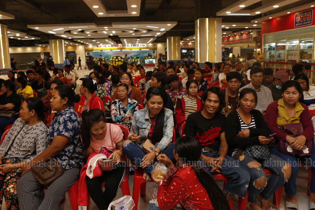 Migrant workers from neighbouring countries wait for registration at a one-stop service centre in Pathum Thani province. The Labour Ministry has updated its list of occupations open to migrant workers and will implement it next month. (File photo by Pattarapong Chatpattarasill)