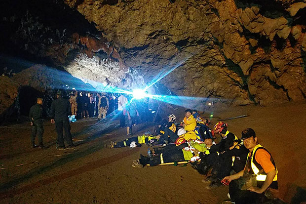 Rescuers stay outside the cave as divers of the Royal Thai Navy SEAL moved inside the cave at Tham Luang Khun Nam Nang Non Forest Park to locate 12 students and their football coach trapped inside. (Photo by Chinnaphat Chaimol)