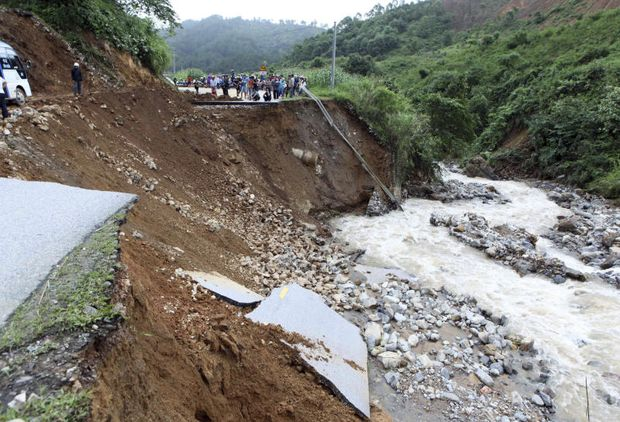 Part of a road is collapsed by landslides in northern province of Lai Chau, Vietnam on Monday. (AP photo)