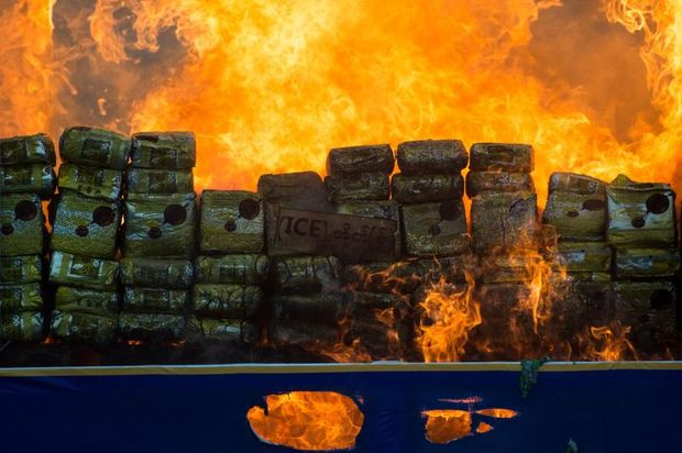 Myanmar law enforcement authorities burn seized illegal drugs worth 187 million USD, marking the International Day against Drug Abuse and Illicit Trafficking in Yangon on Tuesday. (AFP photo)