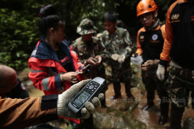 Teams are using the latest technology to survey a nearby creek.Photos and video by Patipat Janthong