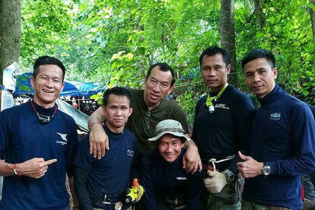 Petty Officer 1st class Saman Gunan, far left, seen in this undated photograph with what appear to be former or present Seals.
