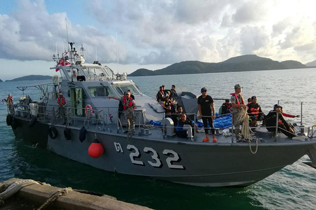 A navy ship brings the bodies of victims pulled from the sea to the shore in Phuket on Friday as the search resumes on Saturday. (Royal Thai Navy photo)