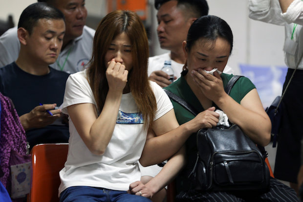 Relatives of Chinese tourists who were on the ill-fated Phoenix gather at a hospital in Phuket. (Reuters Photo)