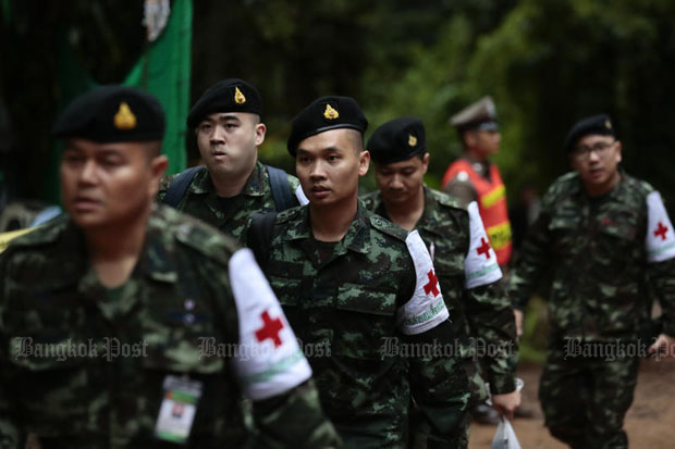 Rescue officials prepare to receive the boys and their coach as evacuation begins at Tham Luang cave in Mae Sai district, Chiang Rai, on Sunday. (Photo by Patipat Janthong)