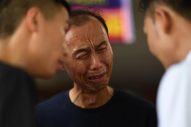 A Chinese relative cries at the Vachira Phuket Hospital in Phuket on Sunday after a tourist boat carrying 105 passengers, mostly Chinese tourists, capsized in rough seas on July 5.  (AFP)