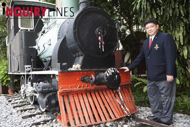 Acting State Railway of Thailand governor Voravuth Mala poses near a decommissioned locomotive at the SRT office. He is leading the authority's preparations for a new chapter to revitalise its operations. (Photo by Pawat Laopaisarntaksin)