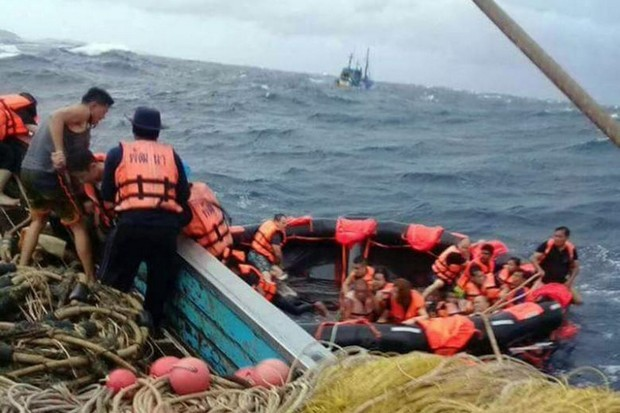 Fortunate survivors from the capsizing of the Phoenix dive boat are rescued from a life raft. (Photo via Facebook)