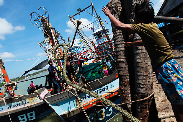 Migrant labourers on a fishing boat docked at a pier in Phangnga province. PATIPAT JANTHONG
