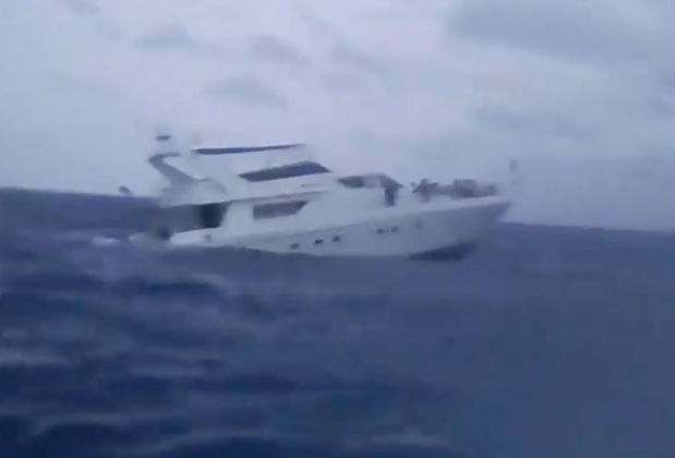 A sinking boat is seen at sea off Phuket, Thailand in this screen grab obtained from a video taken on July 5, 2018. (LOVE ANDAMAN TEAM/via REUTERS)