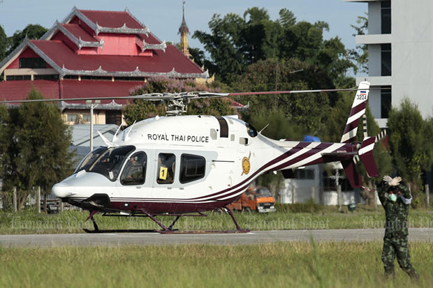 A Royal Thai Police helicopter airlifts the fifth boy from a makeshift pad in Mae Sai district to Wing 416 in Muang district in Chiang Rai on Monday. (Photo by Patipat Janthong)