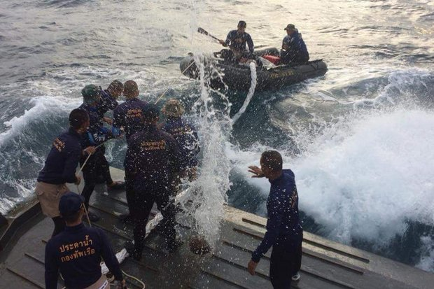 Royal Thai Navy sailors launch a dredging hose in the rough waters off southern Phuket before being forced to abandon the search. (Photo courtesy Public Relations Department)