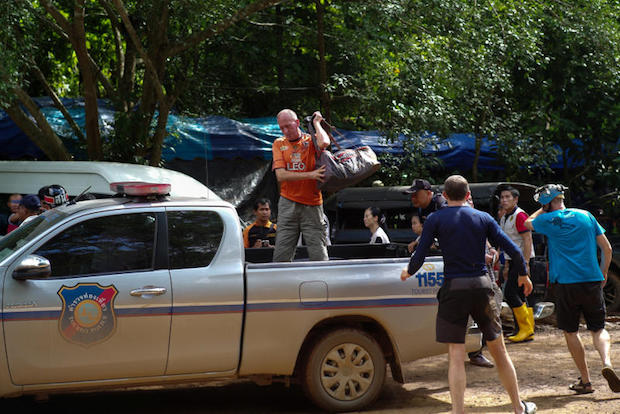 British caver Vernon Unsworth (centre) gets out of a pickup truck near the Tham Luang cave complex, where 12 boys and their soccer coach are trapped, in the northern province of Chiang Rai, Thailand, July 5, 2018. (Reuters photo)