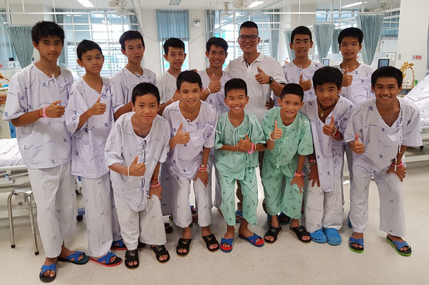Lt Col Pak Loharachun, wearing eyeglasses, poses with the Moo Paa football team at Chiangrai Prachanukroh Hospital in Chiang Rai province. The picture is among many pictures he posted on his Facebook page together with a message about the football team who had been trapped in flooded Tham Luang cave, Chiang Rai, for more than two weeks.