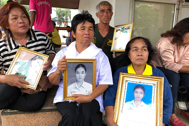 Family members of 18-year-old student Ruadeewan Polprasit, raped and murdered at age 18, at Kalasin Provincial Court on Tuesday to hear the Appeal Court uphold the death penalty for former village chief Krittidech Rawengwan.(Photo: Yongyuth Phuphuangpet)