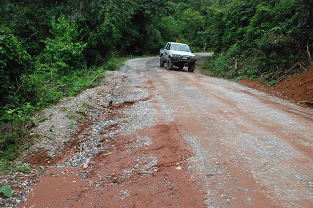 A rough road to three villages in Chattrakan district in Phitsanulok province needs repairs, but the tourism budget does not address the problem for villagers. (Photo by Chinnawat Singha)