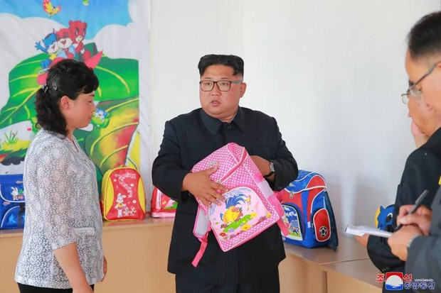 Since the Singapore summit, North Korea's dictator has been rallying support for his economic drive with numerous, highly publicised factory visits such as this one to the Chongjin Bag Factory in North Hamgyong Province. (KCNA photo via AFP)