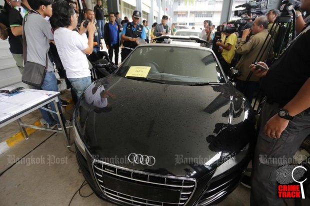 A black Audi coupe is confiscated from a gang which allegedly forged its vehicle registration details. The gang is also suspected of involvement in car theft. (Photo by Wassayos Ngamkham)