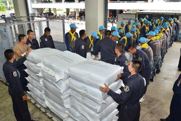 Airmen and volunteers load relief supplies provided by His Majesty the King onto a container to be sent to victims of the dam collapse at the Xepian-Xenamnoy hydro-power project. (Photo courtesy Royal Thai Air Force)