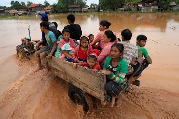 People are seen on a vehicle on Thursday as they travel during the flood after the Xe Pian-Xe Namnoy hydropower dam collapsed in Attapeu province. (Reuters photo)