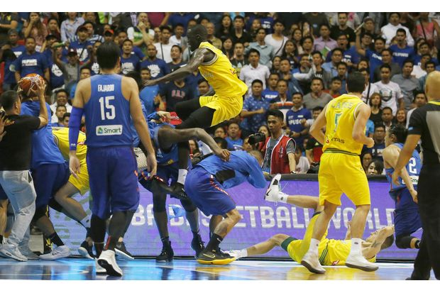 In this July 2 file photo, Philippines and Australian basketball players react during their FIBA World Cup qualifying basketball game at the Philippine Arena in suburban Bocaue township, Bulacan province, north of Manila. (AP photo)
