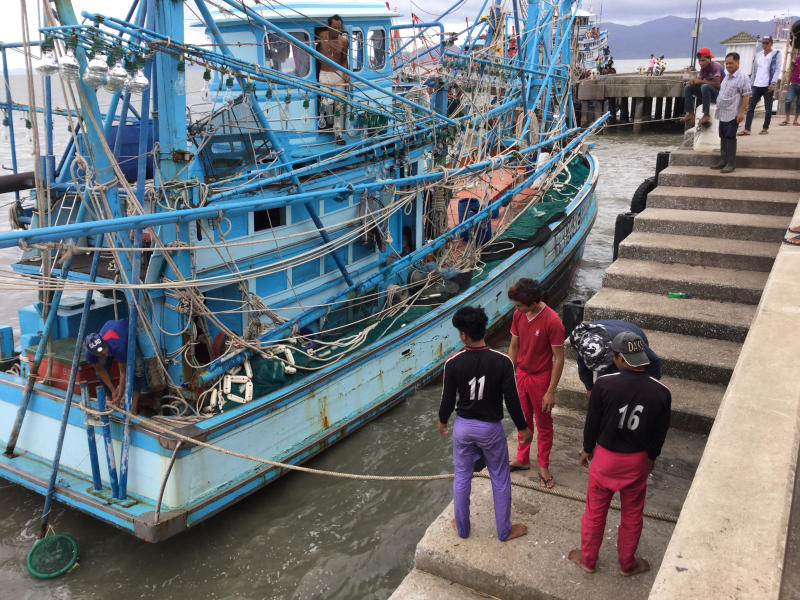 Commercial fishing operators in Phangnga urge the government to bypass the lengthy hiring process for migrant workers or face a strike. (Jakkrit Waewkraihong)