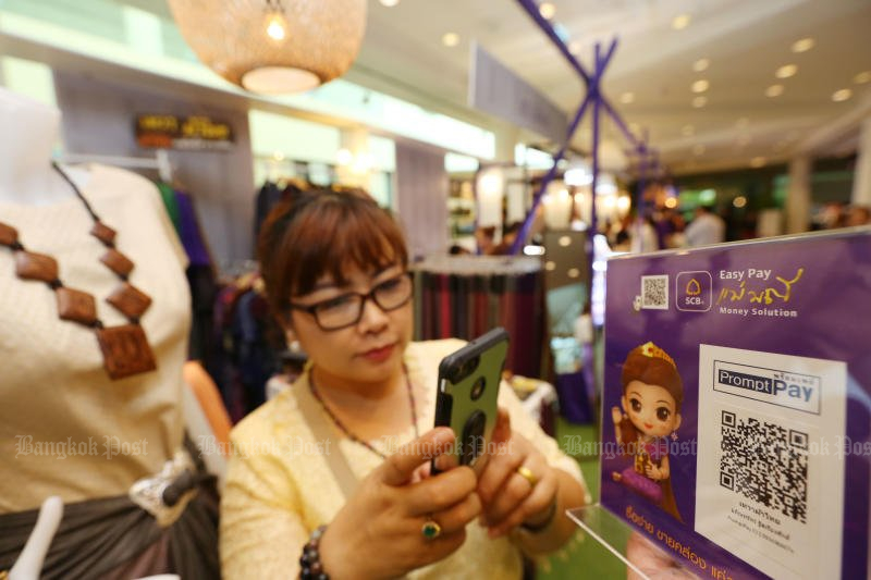 A shopper pays for her goods via her QR code app at a SCB–FTI Factory Outlet sale last month. Mobile payments are now one of the fastest growing trends in commerce. (Post Today photo)