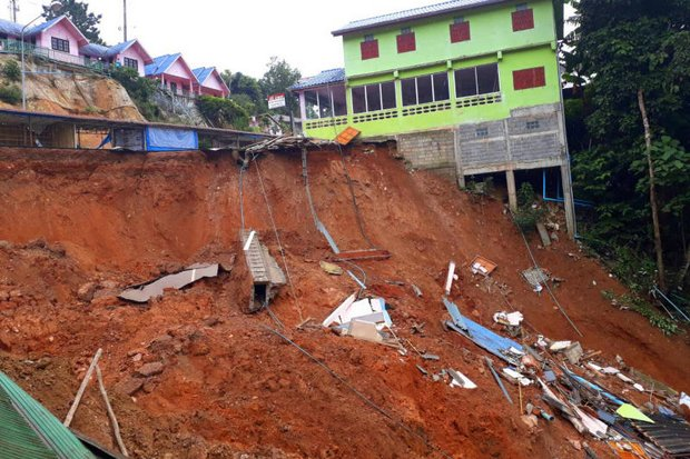 Five concrete buildings are down and another five are teetering as heavy rain pummels the Phu Chi Fah road up the mountain in Chiang Rai. (Photo courtesy Royal Thai Army)