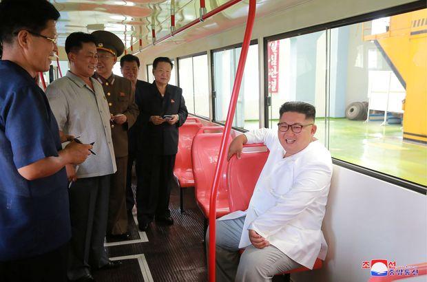 North Korean leader Kim Jong Un visits the Pyongyang Trolley Bus Factory and the Bus Repair Factory in Pyongyang in this photo released on Saturday. (KCNA via Reuters)