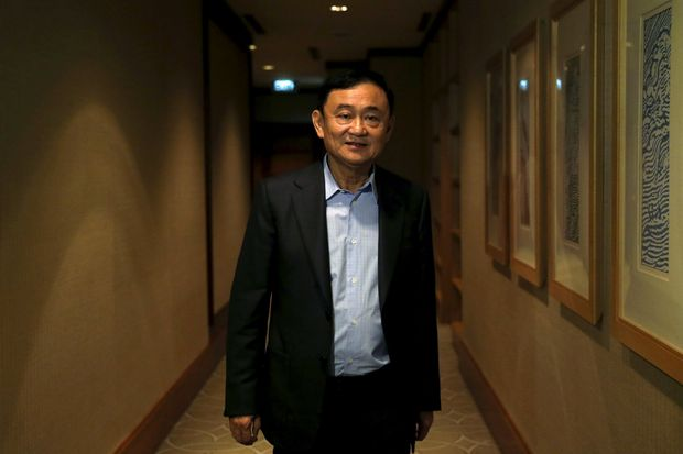 Former pime Minister Thaksin Shinawatra leaves after an interview with Reuters in Singapore on Feb 23, 2016. (Reuters photo)