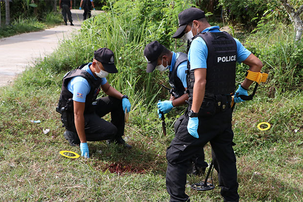 Forensic police collect evidence at the scene of the fatal shooting in Bacho district, Narathiwat, in which a 40-year-old woman and her 18-year-old daughter were shot dead in a drive-by shooting on Saturday morning. (Photo by Waedao Harai)