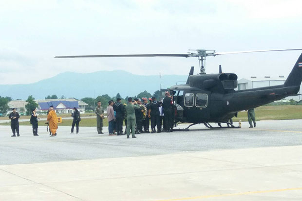 The body of volunteer ranger Phumsak Yenthua, 21, is placed in a helicopter to be transported to his home province of Phatthalung after he was shot dead in Pattani on Saturday morning.
