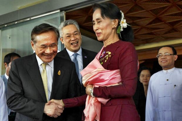 Foreign Minister Don Pramudwinai (left) shakes hands with Myanmar leader Aung San Suu Kyi during a meeting in 2016 in Nay Pyi Taw. Mr Don will attend the 9th Meeting of the Joint Commission for Bilateral Cooperation on Tuesday in the Myanmar capital. (AP photo)