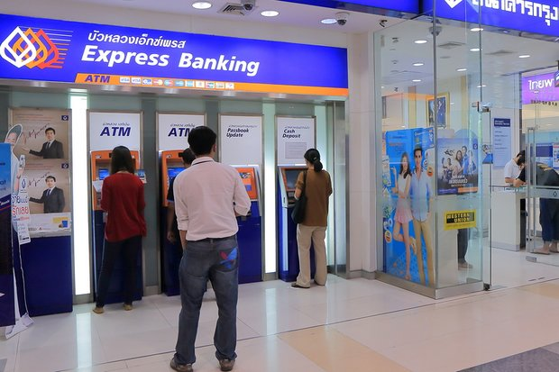 Banks have waived most fees for most transfers of funds performed digitally - and have taken their first-ever loss on such fees as a result. (File photo)