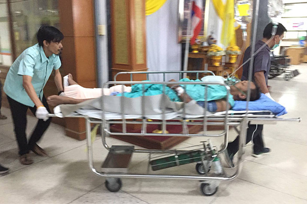 Pol Capt Boonyan Sanbako is sent to Sai Buri Hospital in Sai Buri district, Pattani, after he and his wife were wounded by gunshots in an ambush on Saturday night. (Photo by Abdulloh Benjakat)