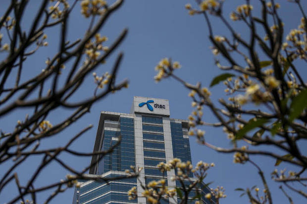 The logo of the DTAC Public Company Limited is pictured at its office building in Bangkok on Feb 25, 2016. (Reuters file photo)